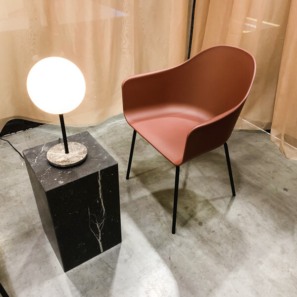 maroon chair with lamp