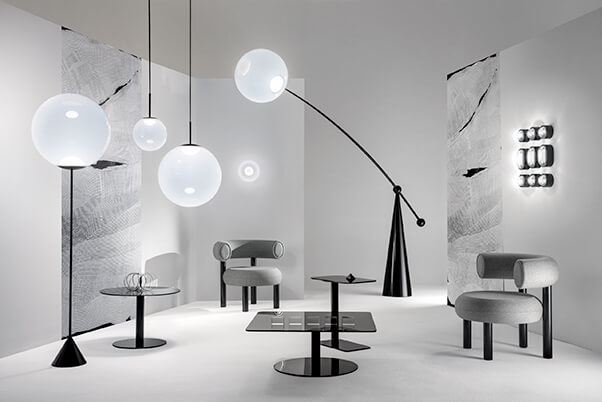 living room with Tom Dixon OPAL floor lamps, pendants and wall lamps with FAT lounge chairs
