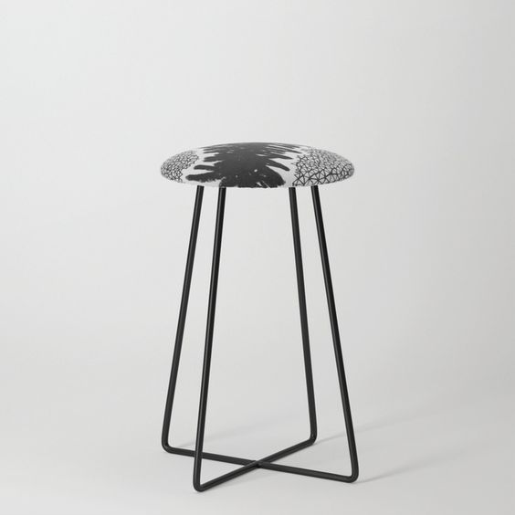 counter stool with black and white patterned seat